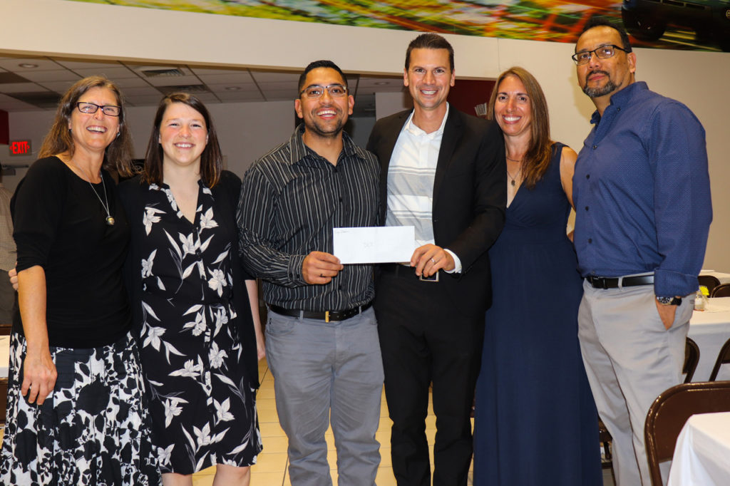 At Noche de Salsa Tony Fajardo presented SLI board members with a $2,000 check from Liga Premier Futbol del Valle Shenandoah — one of many evening highlights. Thank you, Liga Premier!