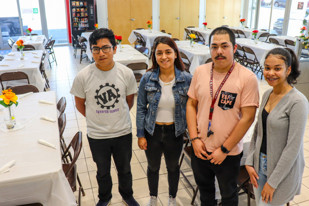 Current SLI scholars helped with Noche de Salsa setup.